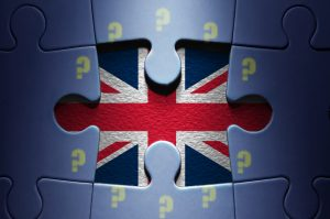 Missing piece from a jigsaw puzzle revealing the British flag question mark European flag