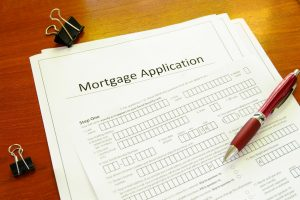 Blank mortgage application with pen and clips