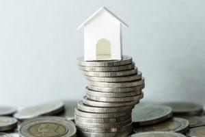 macro-shot-of-financial-mortgage-concept-PTBTZSE