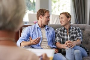 happy-young-couple-taking-financial-advice-at-home