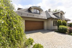 detached-house-exterior-with-cobblestone-driveway
