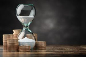 golden-coins-and-hourglass-clock-return-on-investm