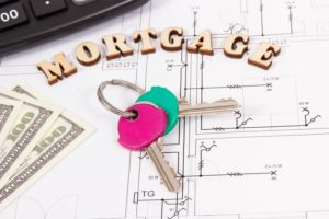 inscription-mortgage-keys-money-and-calculator