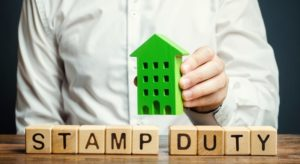 businessman-and-wooden-blocks-with-the-word-stamp