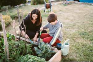 Mother and son working in a vegetable garden