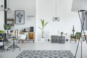 White loft interior in scandinavian style with pattern carpet